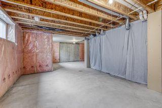 Photo 26: 1401 281 COUGAR RIDGE Drive SW in Calgary: Cougar Ridge Row/Townhouse for sale : MLS®# A1070231