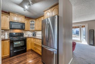 Photo 12: 23 River Rock Circle SE in Calgary: Riverbend Detached for sale : MLS®# A1089273