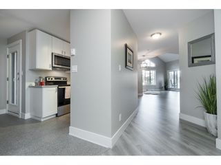 """Photo 3: 406 20288 54 Avenue in Langley: Langley City Condo for sale in """"Langley City"""" : MLS®# R2432392"""