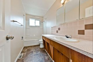 Photo 9: 539 HUNTERPLAIN Hill NW in Calgary: Huntington Hills Detached for sale : MLS®# A1024979