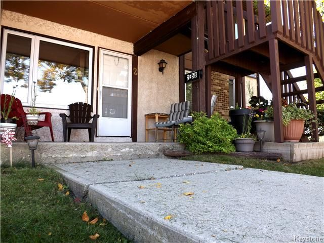 BEAUTIFUL MAIN LEVEL CONDO WITH NICE UPDATED WINDOWS & GREAT LOUNGING SPACE!