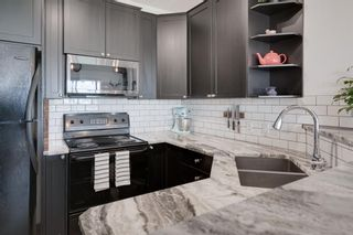 Photo 7: 311 1540 17 Avenue SW in Calgary: Sunalta Apartment for sale : MLS®# A1128304