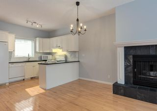 Photo 8: 306 20 Street NW in Calgary: West Hillhurst Row/Townhouse for sale : MLS®# A1130619