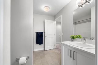 Photo 22: 1404 Jumping Pound Common: Cochrane Row/Townhouse for sale : MLS®# A1146897