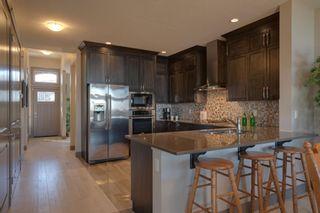 Photo 13: 40 Cougar Ridge Landing SW in Calgary: Cougar Ridge Row/Townhouse for sale : MLS®# A1148928