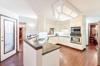 Photo 21: 217 Signature Way SW in Calgary: Signal Hill Detached for sale : MLS®# A1148692