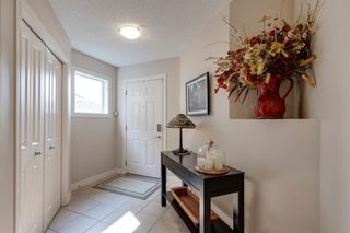 Photo 2: 198 Cougar Plateau Way SW in Calgary: Cougar Ridge Detached for sale : MLS®# A1133331