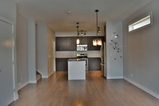 Photo 5: 1 711 17 Avenue NW in Calgary: Mount Pleasant Row/Townhouse for sale : MLS®# A1100885