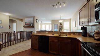 Photo 16: 708 Boulder Creek Drive SE: Langdon Detached for sale : MLS®# A1153144