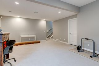 Photo 36: 707 Shawnee Drive SW in Calgary: Shawnee Slopes Detached for sale : MLS®# A1109379