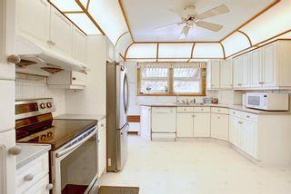 Photo 10: 711 47 Avenue SW in Calgary: Elboya Detached for sale : MLS®# A1081266