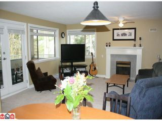 "Photo 1: 205 33675 MARSHALL Road in Abbotsford: Central Abbotsford Condo for sale in ""Huntingdon"" : MLS®# F1005601"