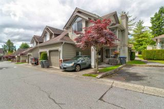 """Photo 1: 413 13900 HYLAND Road in Surrey: East Newton Townhouse for sale in """"Hyland Grove"""" : MLS®# R2589774"""