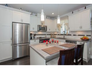 """Photo 11: 23 6929 142 Street in Surrey: East Newton Townhouse for sale in """"Redwood"""" : MLS®# R2110945"""