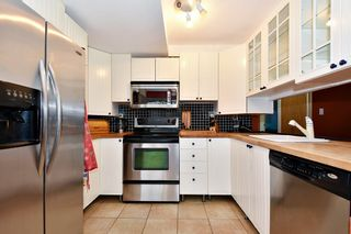"""Photo 6: 7403 TAMARIND Drive in Vancouver: Champlain Heights Townhouse for sale in """"THE UPLANDS"""" (Vancouver East)  : MLS®# R2426145"""
