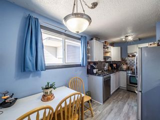Photo 4: 3910 29A Avenue SE in Calgary: Dover Row/Townhouse for sale : MLS®# A1077291