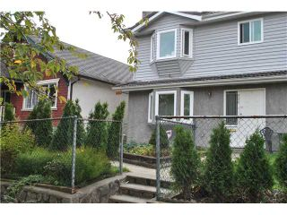 "Photo 1: 908 E 11TH Avenue in Vancouver: Mount Pleasant VE 1/2 Duplex for sale in ""MOUNT PLEASANT EAST"" (Vancouver East)  : MLS®# V854565"