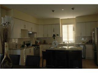 Photo 3: 3686 E GEORGIA ST in Vancouver: Renfrew VE House for sale (Vancouver East)  : MLS®# V1040327