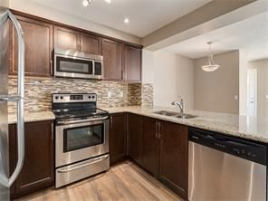Photo 5: 4052 Windsong Boulevard SW in Airdrie: windsong House for sale : MLS®# C4120616