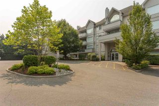 "Photo 1: 408 33708 KING Road in Abbotsford: Poplar Condo for sale in ""College Park Place"" : MLS®# R2195057"