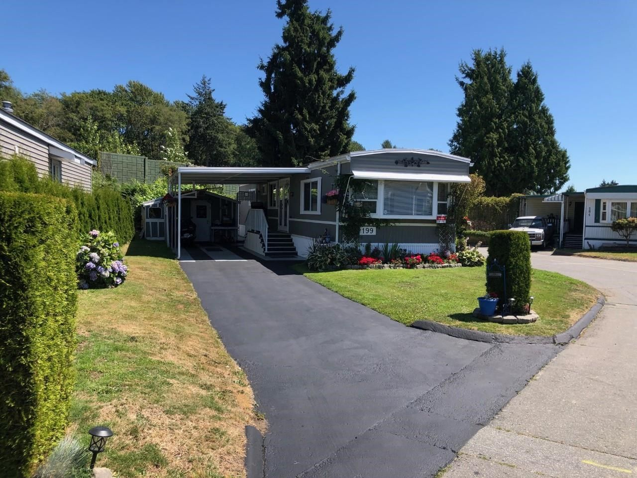 Main Photo: 199 1840 160 Street in Surrey: King George Corridor Manufactured Home for sale (South Surrey White Rock)  : MLS®# R2604438
