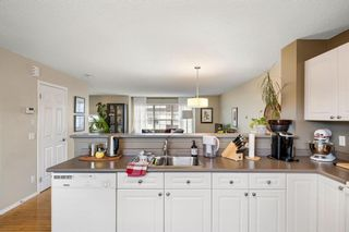 Photo 15: 69 Tuscany Springs Gardens NW in Calgary: Tuscany Row/Townhouse for sale : MLS®# A1112566