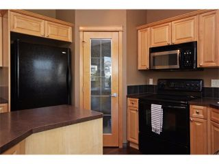 Photo 7: 18 CRYSTAL SHORES Place: Okotoks House for sale : MLS®# C4018955