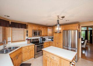 Photo 11: 1119 SUNVISTA Road SE in Calgary: Sundance House for sale : MLS®# C4129627