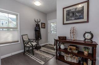 Photo 3: 2 Riviera View: Cochrane Detached for sale : MLS®# A1146270
