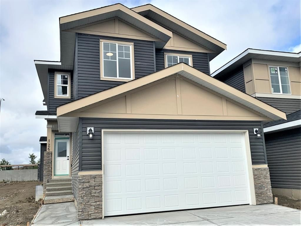 Main Photo: 126 Creekside Way SW in Calgary: C-168 Detached for sale : MLS®# A1144468
