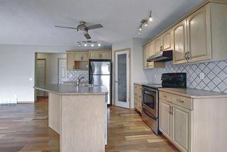 Photo 6: 47 Bow Ridge Crescent: Cochrane Detached for sale : MLS®# A1110520