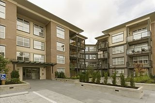 """Photo 1: 416 10707 139TH Street in Surrey: Whalley Condo for sale in """"Aura 2"""" (North Surrey)  : MLS®# F2824909"""