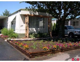 """Photo 1: 184 3665 244TH Street in Langley: Otter District Manufactured Home for sale in """"LANGLEY GROVE ESTATES"""" : MLS®# F1003706"""