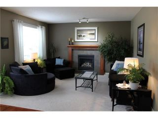 Photo 4: 242 CRYSTAL GREEN Point(e): Okotoks House for sale : MLS®# C4084538