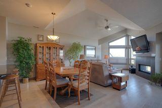 Photo 4: 40 Cougar Ridge Landing SW in Calgary: Cougar Ridge Row/Townhouse for sale : MLS®# A1148928