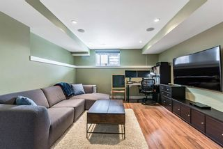 Photo 19: 1562 93 Street SW in Calgary: Aspen Woods Row/Townhouse for sale : MLS®# A1085332