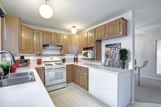 Photo 10: 36 Strathearn Crescent SW in Calgary: Strathcona Park Detached for sale : MLS®# A1152503