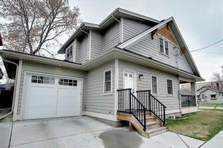 Photo 2: 203 15 Avenue NW in Calgary: Crescent Heights Detached for sale : MLS®# A1071685