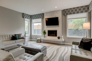 Photo 8: 707 Shawnee Drive SW in Calgary: Shawnee Slopes Detached for sale : MLS®# A1109379