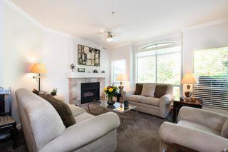 """Photo 1: 301S 1100 56 Street in Delta: Tsawwassen East Condo for sale in """"ROYAL OAKS"""" (Tsawwassen)  : MLS®# R2621715"""