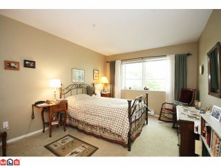 """Photo 8: 215 5765 GLOVER Road in Langley: Langley City Condo for sale in """"COLLEGE COURT"""" : MLS®# F1013966"""