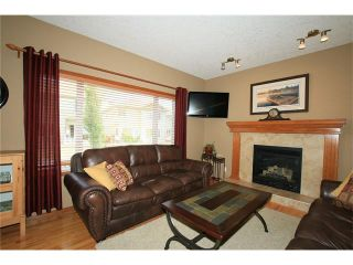 Photo 5: 18 WEST POINTE Manor: Cochrane House for sale : MLS®# C4072318