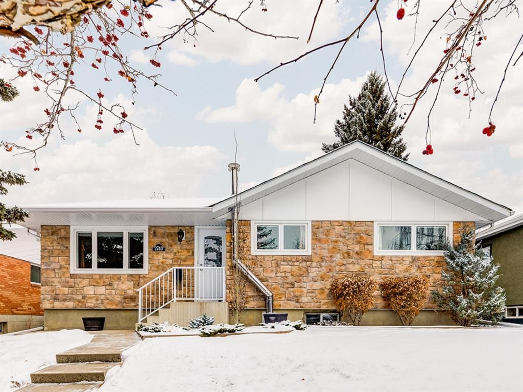 Updated and immaculately-maintained bungalow with English Rubble stone front.