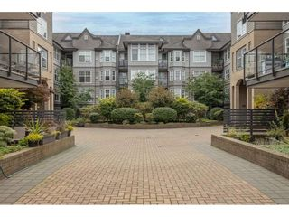 "Photo 2: 405 20200 56 Avenue in Langley: Langley City Condo for sale in ""The Bentley"" : MLS®# R2530044"