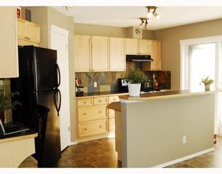 Photo 5: 2 TUSCANY SPRINGS Heights NW in CALGARY: Tuscany Residential Detached Single Family for sale (Calgary)  : MLS®# C3392586