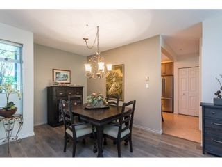 """Photo 12: 102 2733 ATLIN Place in Coquitlam: Coquitlam East Condo for sale in """"ATLIN COURT"""" : MLS®# R2475795"""