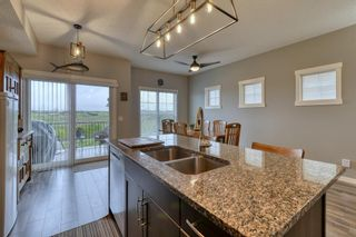 Photo 5: 643 101 Sunset Drive N: Cochrane Row/Townhouse for sale : MLS®# A1117436