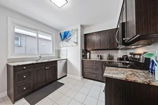 Photo 11: 710 53 Avenue SW in Calgary: Windsor Park Semi Detached for sale : MLS®# A1067398