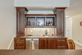 Photo 28: 14 347 Tuscany Estates Rise NW in Calgary: Tuscany Row/Townhouse for sale : MLS®# A1074434