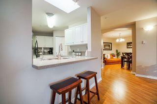 "Photo 5: 402 20277 53 Avenue in Langley: Langley City Condo for sale in ""METRO 2"" : MLS®# R2540357"
